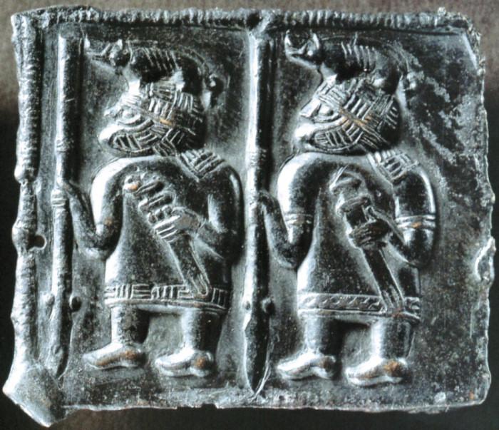 Bronze plate from Öland island, boar helmets.